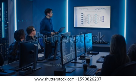 Team of Professional IT Developers Have Meeting, Speaker Talks about New Blockchain Based Software Development Shown on TV. Concept: Deep Learning, Artificial Intelligence, Data Mining, Neural Network