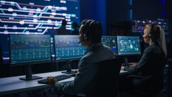 Team of Professional Traders Talking into Headsets Work on Computers with Screen Showing Finance Statistics, Charts Strategy, Stock, Telemarketing. Stock Firm Monitoring Room Stock Market Specialists
