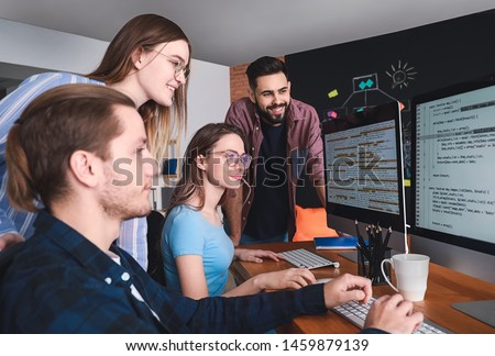 Team of programmers working in office