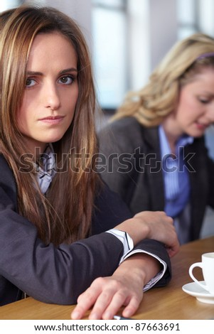 Team of 2 stressed and depressed business people sitting at conference table, negotiation failure or bankruptcy concept