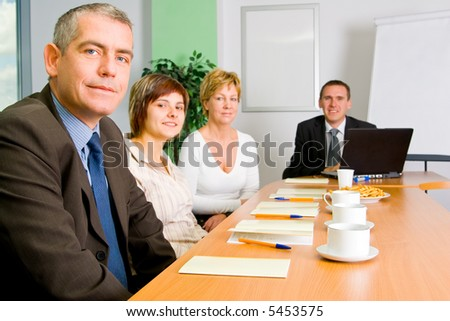 Team of successful business people on the meeting (training).
