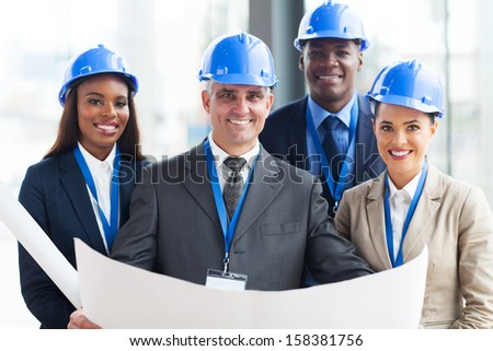 team of successful construction managers in office