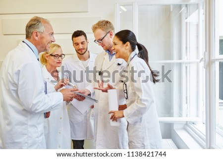Team of successful doctors laughing with joy in meeting