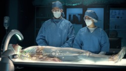 Team of surgeons perform a delicate operation using modern high-tech medical full body surgical augmented reality scanner on female patient laying on futuristic holographic bed showing skeletal system