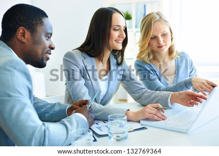 Team of three considering optimal business solutions