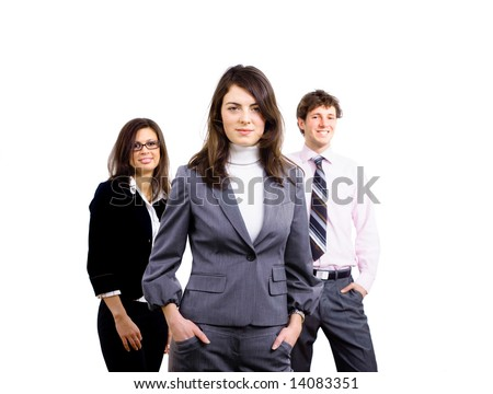 Team of three young business people standing and posing for portrait, smiling businesswoman in front.