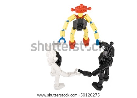 team of toy bricks people in a circle with a leader