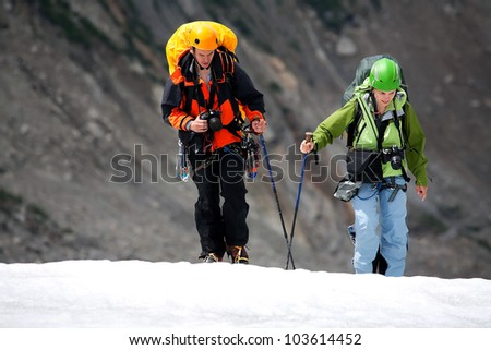 Team of two alpinists crossing Mer de Glace, Haute Savoie, France