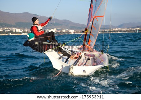 Team of two girls deftly managed to sail in the sea