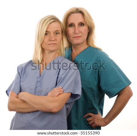 team of two happy and confident female doctors or nurses medical personnel wearing colorful scrubs clothes