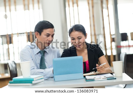 Team of white-collar workers discussing new project - stock photo