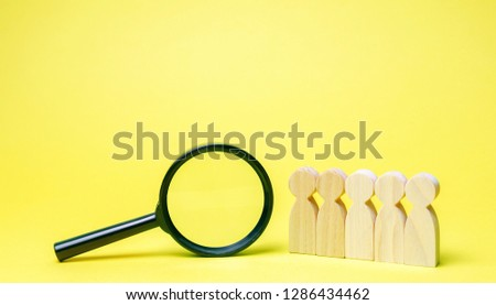 Team of workers and magnifying glass. Search for people. Attraction to work. Human Resource Management. Hiring. Promotion. Talented worker. Working staff. Employee
