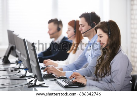 Team Of Young Customer Support Phone Operators Working In Office #686342746
