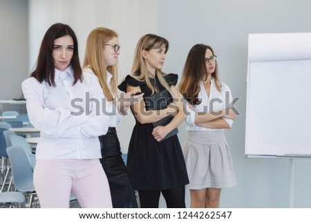 Team office staff. Management staff at the meeting. Summing up the activities. The chief scolds subordinates. Teamwork. Gender equality. The joy of a good deal. Attentive look, focus on the result. #1244262547