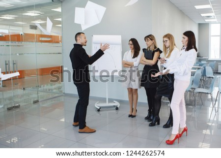 Team office staff. Management staff at the meeting. Summing up the activities. The chief scolds subordinates. Teamwork. Gender equality. The joy of a good deal. Attentive look, focus on the result. #1244262574