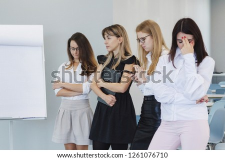 Team office staff. Management staff at the meeting. Summing up the activities. The chief scolds subordinates. Teamwork. Gender equality. The joy of a good deal. Attentive look, focus on the result. #1261076710