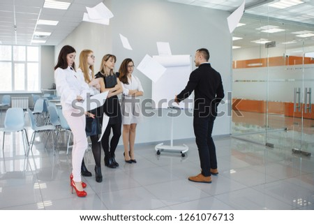 Team office staff. Management staff at the meeting. Summing up the activities. The chief scolds subordinates. Teamwork. Gender equality. The joy of a good deal. Attentive look, focus on the result. #1261076713