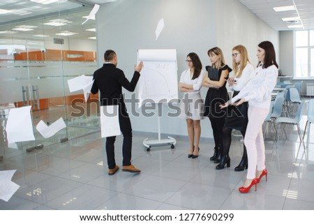 Team office staff. Management staff at the meeting. Summing up the activities. The chief scolds subordinates. Teamwork. Gender equality. The joy of a good deal. Attentive look, focus on the result. #1277690299