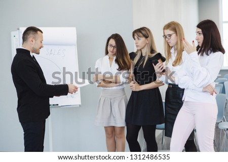 Team office staff. Management staff at the meeting. Summing up the activities. The chief scolds subordinates. Teamwork. Gender equality. The joy of a good deal. Attentive look, focus on the result. #1312486535