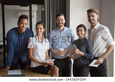 Team portrait of happy diverse professional corporate business people in office, smiling multicultural employees group looking at camera, international workers staff human resource posing together