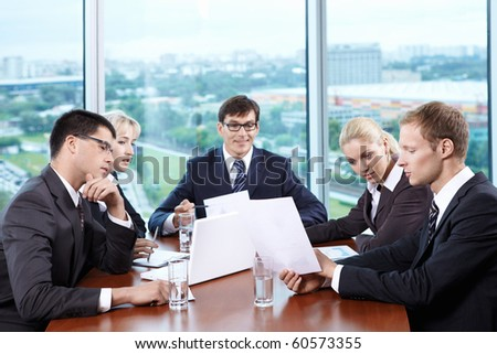 Team staff leads a discussion in the office