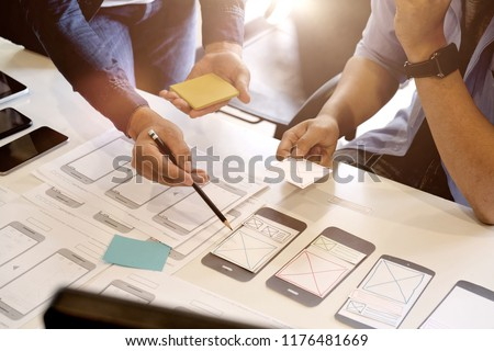 Team ux designer creative graphic planning application development a prototype smartphone layout. #1176481669
