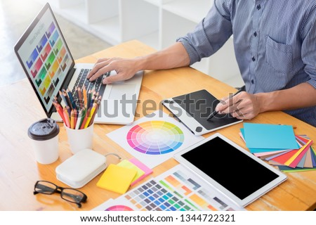 team Web designer working drawing something on graphic computer in the office or studio