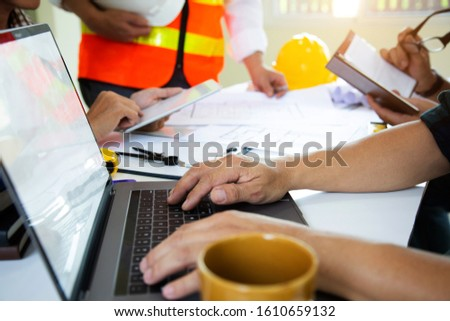 Team work Architectural work site desk background construction project ideas concept, With drawing equipment