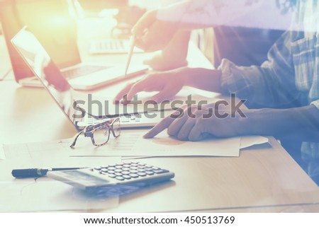 Team work meeting concept,business documents on office table with laptop computer and graph financial with social network diagram and colleagues discussing data.selective focus,vintage color #450513769