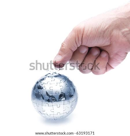 Team work Organization concept with globe puzzle