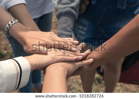 Team work put hands together. friends team concept