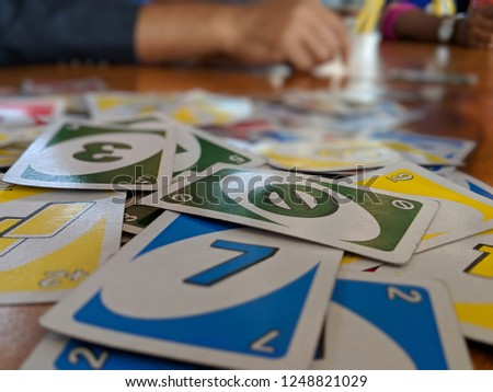 Team work with uno cards #1248821029