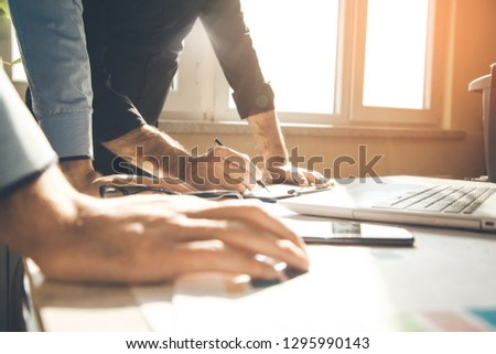 team working in office desk #1295990143