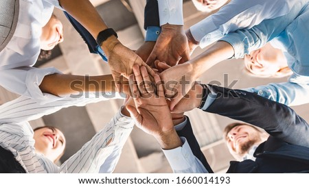 Teambuilding Concept. Coworkers Standing In Circle Holding Hands Together Celebrating Business Success In Modern Office. Panorama, Bottom View Photo stock ©