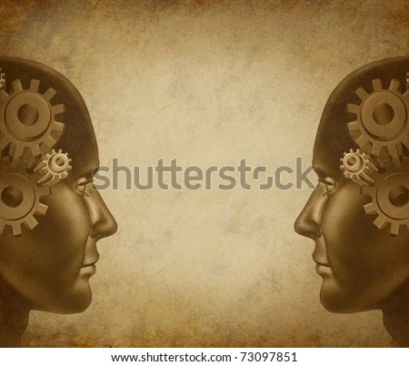 Teamwork and communication symbol represented by two human heads using their brains and minds to work together as a partnership and build a successful business together.