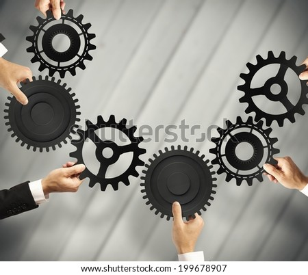 Teamwork and integration concept with connection of gear
