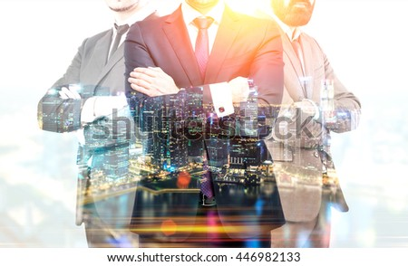 Teamwork and partnership concept with businesspeople crossing arms on illuminated Singapore city background at night. Double exposure