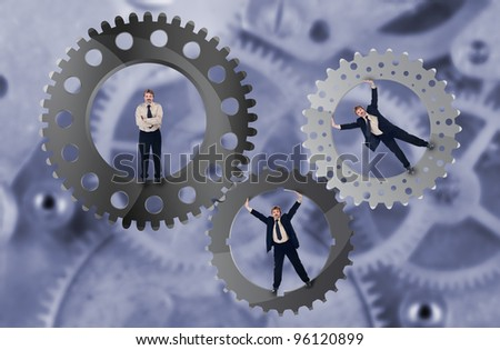 Teamwork and team effort concept with businessman and cogwheels
