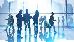 Teamwork and trading concept. Silhouettes of business people in office with double exposure of blurry digital graph. Toned image