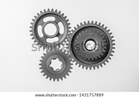 Teamwork business concept - top view of 3 metal gear isolated on white background for mockup. real photo, not 3D render