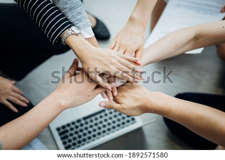 Teamwork business join hand together concept, Business team standing hands together, Volunteer charity work. People joining for cooperation success business.