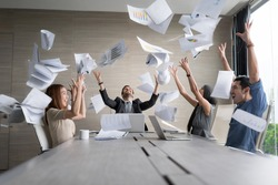Teamwork business people excited happy smile, throw papers and documents fly in air. Success team concept after sign contract.In selective focus and motion blur moving with perspective view.