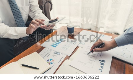 teamwork company meeting concept, business partners working with laptop computer together analysing startup financial project result or strategy plan and discussing data document in office