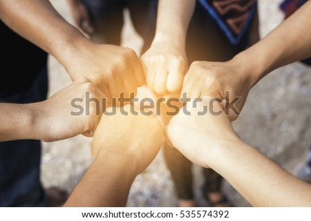 Teamwork concept,Business team standing hands together in the office. people joining hands holding altogether,jointly, simultaneously, abreast, cooperation success business concept,vintage color