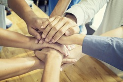 Teamwork concept.Business team standing joining hands together in the office.Group of Diverse Multiethnic People Partnership participation. selective focus,vintage color