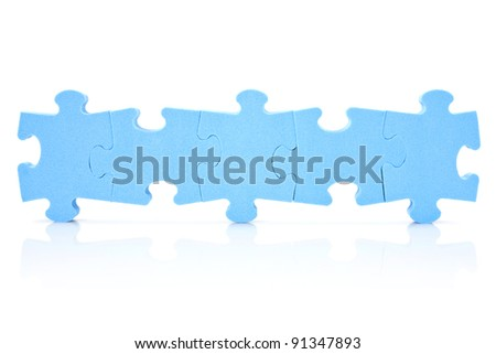 teamwork concept. five puzzle pieces connected in a row