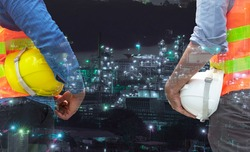 Teamwork concept. Two engineer man holding safety helmet hat protective in their hands while standing over petroleum oil background. Double exposure of engineer with oil refinery industry plant.