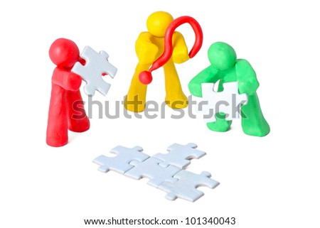 teamwork concept with plasticine people with puzzles