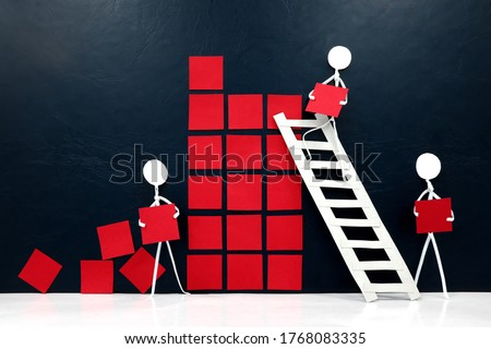 Teamwork, cooperation and rebuilding business economy concept. Human stick figures fixing broken building blocks. Stockfoto ©