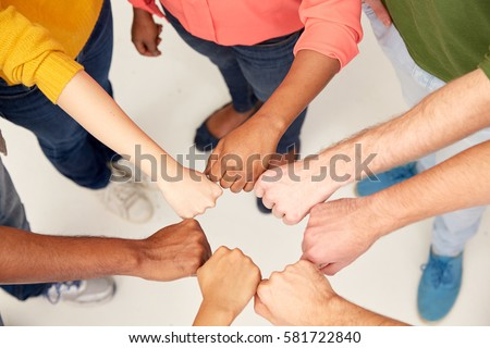teamwork, friendship, international, gesture and people concept - group of hands making fist bump #581722840